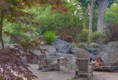OUTDOOR FIREPIT WITH BOULDERS | Elevate: Boulder Fire Pit with Large Bluestone Patio
