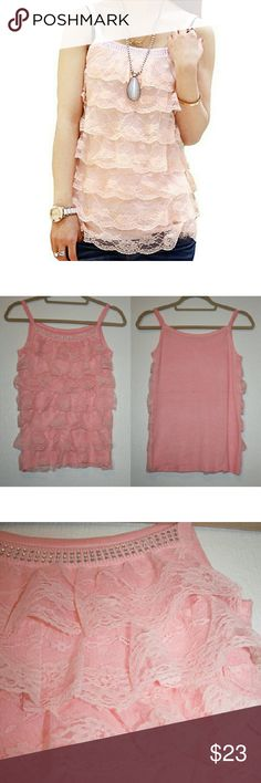 SALE ITEM Lace Ruffle Pink Knit Tank NWOT This tank is beautiful and feminine. It has little rhinestones at the top and tiered ruffle lace layers on the front. The knit fabric underneath is very soft and has stretch to it. The ruffles camouflage any bulges, so it's certainly flattering. Looks fabulous dressed up or dressed down! 22% OFF THIS WEEKEND ONLY! Tops Tank Tops