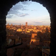 Sunset over Bologna from the window of a medieval tower - Instagram by enricobelgrado