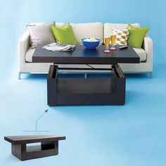 Lift-Top Coffee Table. The mechanism inside allows you to raise the table to a perfect height for dining or use as a desk. It even has built-in drawers for storage.