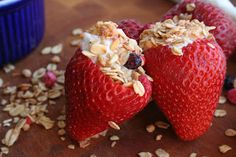 healthy! strawberries filled with yogurt and topped with your favorite oatmeal!