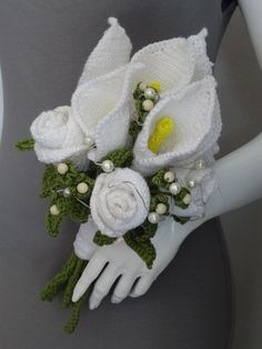 This white and Pearl wedding bouquet incorporates traditional crochet skills, with modern craft techniques
