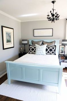 Small Bedroom Using Black Chandelier Over Blue Bed Frame And Light Grey Wall Colors : The Right Small Bedroom Colors For Good Impact