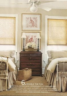 twin beds with linen bed skirts.  i like that the beds are two different beds, but similar styles!