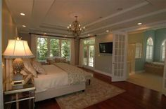 Master bedroom. I like the double doors leading into the bathroom and all of the natural light.