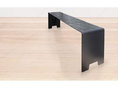 Chris Johnson's Imprint Collection features a deep etched design that replicates a textile cushion. The sleek, lightweight seating is easily transported either inside or outdoors. KIWI DESIGN C… Bench Stool, Dining Bench, Dining Chairs, Black Bar Stools, Kiosk Design, Black Stains, Black Rubber, Cushions
