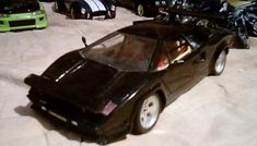 """One of my favorite """"Movie Hero Cars"""" is this stunning Lamborghini Countach (1/18 diecast) From the original 1981 blockbuster movie, """"Cannonball Run"""" , Featuring stars. Such as Burt Reynolds, Dom Deloise, Farah Facett, Roger Moore and a ton of other superstars made this movie an instant """"80's"""" Classic.  The opening scene from that movie is one of my favorite car chases of all time.  It may not be a movie that is shot in the very technical, """"green screen"""" make believe way that most action…"""