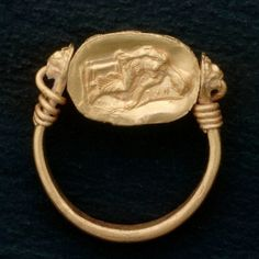 Ancient European Gold Ring With Seated Figure of a Woman.