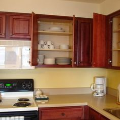 After years of cooking, grease can build up on kitchen cabinets.