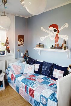 I like the quilt on this. Lightens it up a bit. pirate boy's bedroom  #HoustonNewHomesForSale