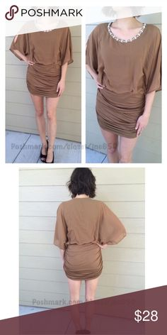 "Brown dress Brown dress Availability- S • 1 S: L 35"" B 34""-44"" Materials: 100% polyester. Contrast is 93% polyester/ 7% spandex. Fully lined (tank/ bodycon lining). Very stretchy and has a jeweled neckline. Cold shoulders.Model is a S/4 and wearing a size S.  ⭐️This item is brand new with manufacturers tags, boutique tags, or in original packaging. 🚫NO TRADES 💲Fair offers will be accepted 💰Ask about bundle discounts Dresses Mini"