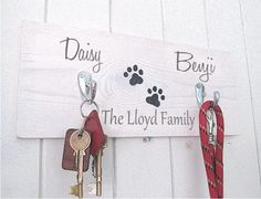 Personalised Wooden Paw Print Wall Key/Pet Lead by MakeMemento, £25.00 | See more about family names, paw prints and names.