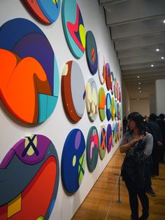 Kaws Circle paintings from opening show in Atlanta by arrestedmotion.com