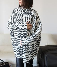 A black and white pattern reminiscent of radio waves gives this wool cape a touch of avant-garde edge. #etsy