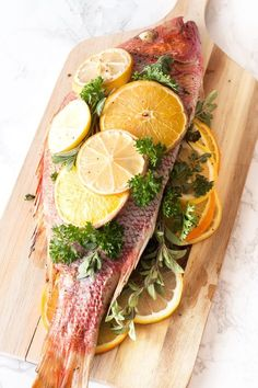 A Roasted Citrus & Herb Red Snapper stuffed with lemons, oranges and herbs is the perfect bright and light recipe for an easy, impressive weeknight dinner. Fish Dishes, Seafood Dishes, Fish And Seafood, Seafood Recipes, Cooking Recipes, Healthy Recipes, Grilled Fish Recipes, Whole Red Snapper Recipes, Whole Fish Recipes