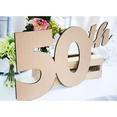 """This Anniversary sign can be used as a guestbook alternative to gather the signatures from your anniversary party or it can be used as a fun anniversary photo prop or gorgeous party decoration. Available in variety of fun colors including shimmery metallics and sparkling glitter! APPROX SIZE - 12"""" tall x 18"""" wide { Precision cut in 1/4"""" thick wood. } If you would like a different number, please e-mail us for a custom listing! **AS SEEN IN SOUTHERN WEDDINGS MAGAZINE V6!** Our painted photo…"""