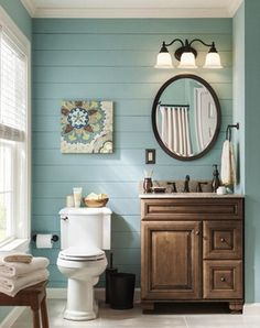 Make a splash in your bathroom with a pop of color and a new vanity. Would have to change the ugly granite to white!