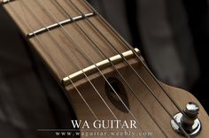 Brass Nut | More consistent tone between open and fretted strings.