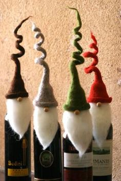 """curly hat santa wine toppers Wine toppers make the gift of wine incredibly special, and these charming santas with whimsical, curly hats will be an instant hit at any holiday party this season! Set of four. One of each color. 11""""t Item ID: 560-10109 6 Tell a Friend $39.00"""