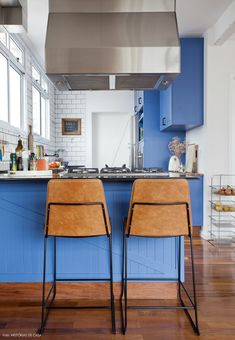 Amazing blue kitchen with vintage cabinets and white subway tiles