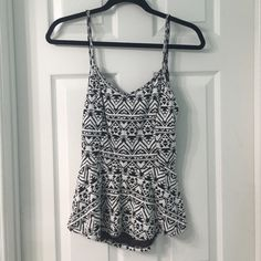CHARLOTTE RUSSE PEPLUM TOP NEW WITHOUT TAGS. CHARLOTTE RUSSE AZTEC DESIGN PEPLUM TOP. BLACK & WHITE STRETCHY MATERIAL. BACK SIDE HAS CIRCULAR CUT OUT OPEN DESIGN. SIZE LARGE. Charlotte Russe Tops
