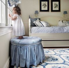 Such a lovely room! The skirted gingham footstool, floral balloon shades, small print WP and Delft blue rug...