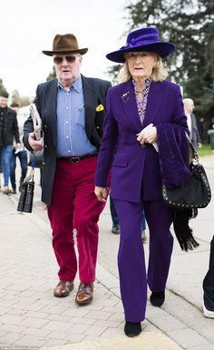 A bold pairing! This woman's purple trouser suit was one of the brighter looks of the day while her companions red velvet trousers ensured he didn't fade into the background