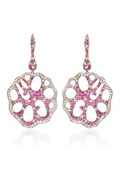 "Be pretty in pink on your next big night out with Haute Vault's exquisite earrings. Beautifully crafted in 18K rose gold, featuring an intricate pink sapphire and diamond cut out design. Wear with a polished updo and rose gold and diamond cocktail ring for an extra dose of sophistication and glamour. Measures 2 1/2"" long and 3/8"" wide"
