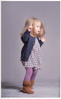 Not sure about the purple tights, but the dress and sweater are precious!
