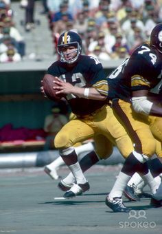 Pittsburgh Steelers quarterback (12) Terry Bradshaw in action at Three Rivers Stadium.