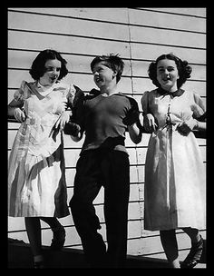 A classic photo of a young, Judy Garland, Mickey Rooney and Deanna Durbin