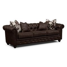 This might be the winner. Cheap. Pretty. Cow pillows. Marquette Chocolate Leather Sofa | Furniture.com $679.99