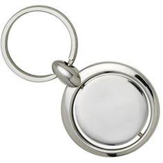 Chaveiro CHR010          Chaveiro de metal formato circular.     Com placa central com movimento girátorio.     Acabamento níquel.
