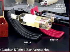 Gravity Leather Wine Bottle Holder - Black by HomeWetBar, http://www.amazon.com/dp/B000FG0PRW/ref=cm_sw_r_pi_dp_IR8Hrb0RV6YEW