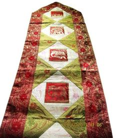Valentines Day Birthday or Housewarming Gift Ideas Silk Table Runner Set with Hand Worked Brocades & Embroidery for Dinnerware a Dining Table Decorative or Kitchen Accessory - 80 * 16 Inches by India Ethnicity. $49.99. Easy To Clean By A Simple Hand Wash or Dry Clean. A Wonderful Gift Idea. Thread Work By Artisans From The Religious Indian City of Banaras. Handwoven Table Runner With Silk Brocades. L - 79.9 * B - 16.1  - Inches. A beautiful table runner hand woven with Patchwo...