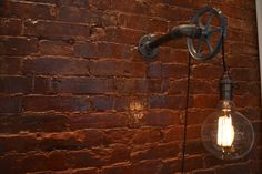 DESCRIPTION: This industrial light is flexible enough to work in a home, retail space, or office. This light uses our custom steel pulley wheel combined with vintage cloth wire to hang the light. From the wall to the end of the pulley is 8 (this can be customized just let us know