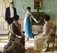 Downton Abbey;  Masterpiece Theatre  series is set in post Edwardian (1901-1910) England and begins in 1912.  It was shot at Highclere Castle in Newbury, which is part of Hampshire, England. Formal Salon features green silk damask upholstered walls.