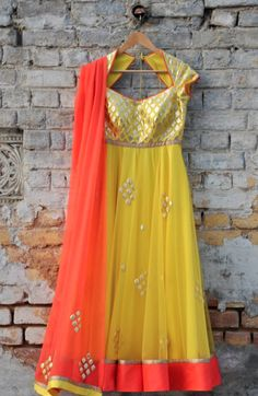 Amrita Thakur. Yellow chiffon anarkali with orange chuni and gold work. Love the key hole back :) #heartstrings