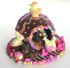 chocolate panoramic eggs - Google search.  Probably even easier than a sugar egg - and you can eat it without going bonkers!