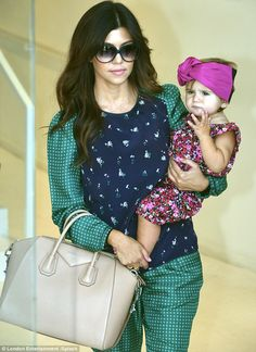Florals: Penelope stole the show amid the crowds of fans outside the Dash store in her pretty outfit