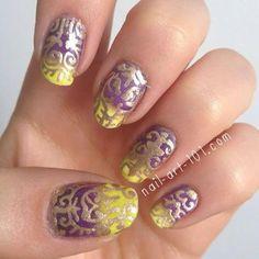 Purple & yellow intricate nail art. I like the color combo!