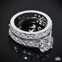 Magnificently crafted, the 'Magnolia' Diamond Wedding Set is a prime example of perfection. The 'Magnolia' Diamond Engagement Ring shines with 16 A CUT ABOVE® Hearts and Arrows Diamond Melee (0.60ctw; F/G VS), while the