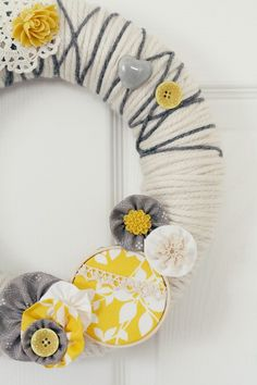yarn wreath (cute for Arise and Shine decor)   or an all yellow flower (which i have) wreath.   (also can use my white door hanger w/ yellow stems)
