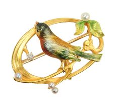 Krementz & Co. circa 1910 brooch/watch holder with bird.  Made of 14k yellow gold and enamel,  translucent guilloche enamels of bronze, teal, navy and French yellow with  pearls, enameled leaves and a European cut diamond.