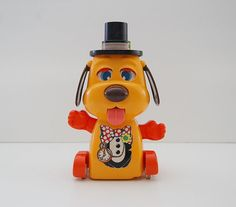 TOMY Dog Toy, Orange and Red With Pocket Watch and Black Top Hat, Sticks his tongue out...