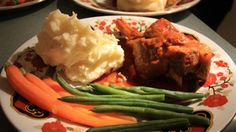 Lamb Shanks Casserole in a Rich Mushroom Sauce served with Mashed Potato, Baby Carrots and Green Beans