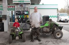 Martin Parr. Bryan Short and Bryan Short, Jr., Hess Gas Station, Rochester, New York. – via Postcards From America