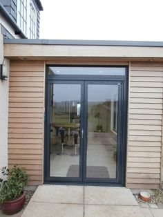 A Solarlux SL60e Bi-Fold Door installation, installed within a Larch clad contemporary extension, designed and installed by Callum Walker Energy Source