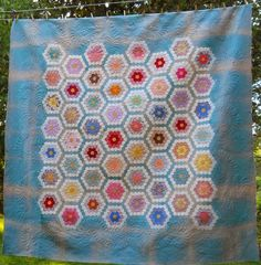 Cascade Quilts: grandmother's flower garden hexagon quilt.  Vintage top spectacularly quilted!