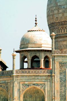 MUGHAL ARCHITECTURE: Detail view of the Taj Mahal. The Taj is the most beautiful monument built by the Mughals, the Muslim rulers of India. Taj Mahal is built entirely of white marble. constructed over a period of twenty-two years, employing twenty thousand workers. It was completed in 1648 C.E. The construction documents show that its master architect was Ustad 'Isa, the renowned Islamic architect of his time.